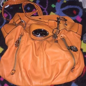 Never used rosetti brand purse orange